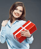 Beautiful girl student hold red gift box. Royalty Free Stock Photo