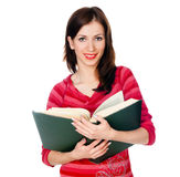 Beautiful girl student reading a book Stock Photos