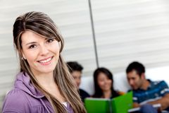 Beautiful girl with students Stock Image