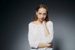 Beautiful girl studio portait on dark background Royalty Free Stock Image