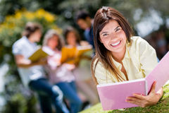 Beautiful girl studying outdoors Stock Images