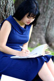 Beautiful girl studying in park Stock Photo
