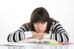 Beautiful girl studying sitting at the table with books and penc Stock Photography