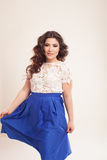 Beautiful girl styling curls hairstyle smiles Stock Photos