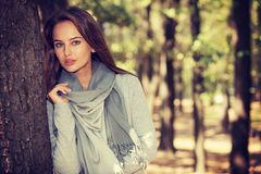 Beautiful  girl in stylish fashion clothes in autumn Park. Royalty Free Stock Photo