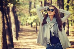 Beautiful  girl in stylish fashion clothes in autumn Park. Royalty Free Stock Photos