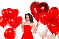 Beautiful girl, stylish fashion model with balloons in the shape Royalty Free Stock Photography