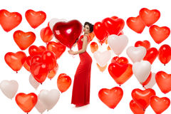 Beautiful girl, stylish fashion model with balloons in the shape Stock Photo