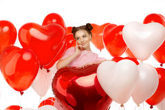 Beautiful girl, stylish fashion model with balloons in the shape Stock Photos