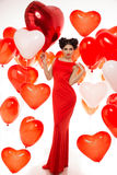 Beautiful girl, stylish fashion model with balloons in the shape Royalty Free Stock Image