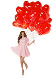 Beautiful girl, stylish fashion model with balloons in the shape Stock Image