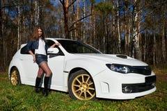 Beautiful girl and stylish white sports car Royalty Free Stock Image