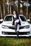 Beautiful girl and stylish white sports car. On nature Stock Photography