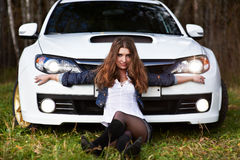 Beautiful girl and stylish white sports car Stock Photo