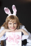 Beautiful girl in a suit of a hare with a gift Stock Photo