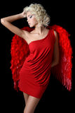 The beautiful girl in a suit of a red angel Stock Images