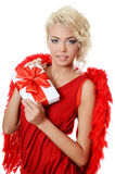 The beautiful girl in a suit of a red angel Royalty Free Stock Photography