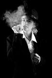 Beautiful girl in a suit, smoking Stock Photos