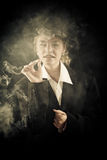 Beautiful girl in a suit, smoking Royalty Free Stock Images