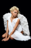 The beautiful girl in a suit of a white angel Stock Photography