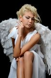 The beautiful girl in a suit of a white angel Stock Images