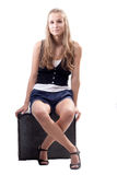 Beautiful girl with a suitcase. Studio shooting Royalty Free Stock Images