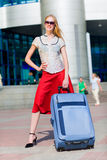 Beautiful girl with a suitcase against Stock Photo
