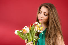 Beautiful girl in a summer dress with tulips Royalty Free Stock Photo