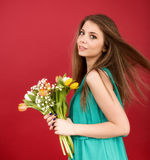Beautiful girl in a summer dress with tulips Royalty Free Stock Photography