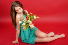 Beautiful girl in a summer dress with tulips Stock Photo