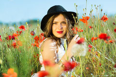Beautiful girl in a summer field Royalty Free Stock Image
