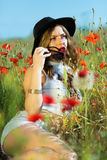 Beautiful girl in a summer field Stock Image