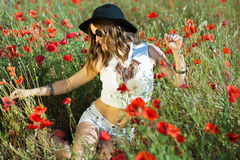 Beautiful girl in a summer field Stock Photo