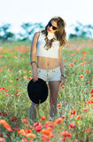 Beautiful girl in a summer field Stock Images