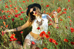 Beautiful girl in a summer field Stock Photos