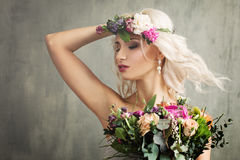 Beautiful Girl with Summer Flowers, Make up. And Curly Hair Stock Photo