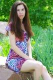 Beautiful girl in a summer garden. Beautiful girl in a green summer garden Royalty Free Stock Photo