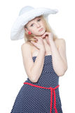 Beautiful girl in a summer hat over white Royalty Free Stock Photography
