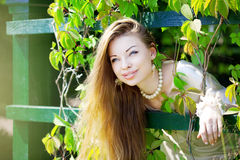 Beautiful girl in a summer park Stock Photography