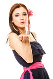 Beautiful girl in summer style blowing kiss. Flirty Royalty Free Stock Photos