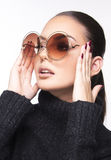 Beautiful girl with summer sunglasses and eye wear close up commercial concept. Retro and new trends Stock Photos
