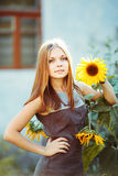 Beautiful girl with sun flower Stock Images