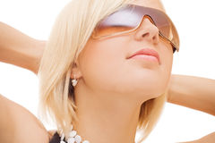 Beautiful girl in sun glasses. On white background Stock Photo