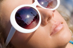 Beautiful girl in sun glasses. Beautiful girl face in big white sun glasses Royalty Free Stock Image