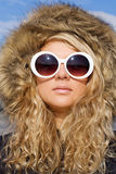 Beautiful girl in sun glasses. Beautiful girl with curly hair in white sun glasses Stock Photo