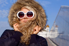 Beautiful girl in sun glasses. Beautiful girl with curly hair in white sun glasses Stock Images