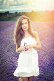 Beautiful girl in the sun in lavender Stock Photography