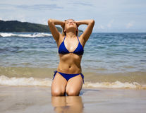 Beautiful girl sunbathes on a beach in Thailand Royalty Free Stock Photo