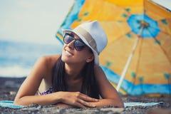 Beautiful girl is sunbathing on the beach Stock Image