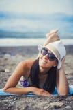 Beautiful girl is sunbathing on the beach Stock Photos